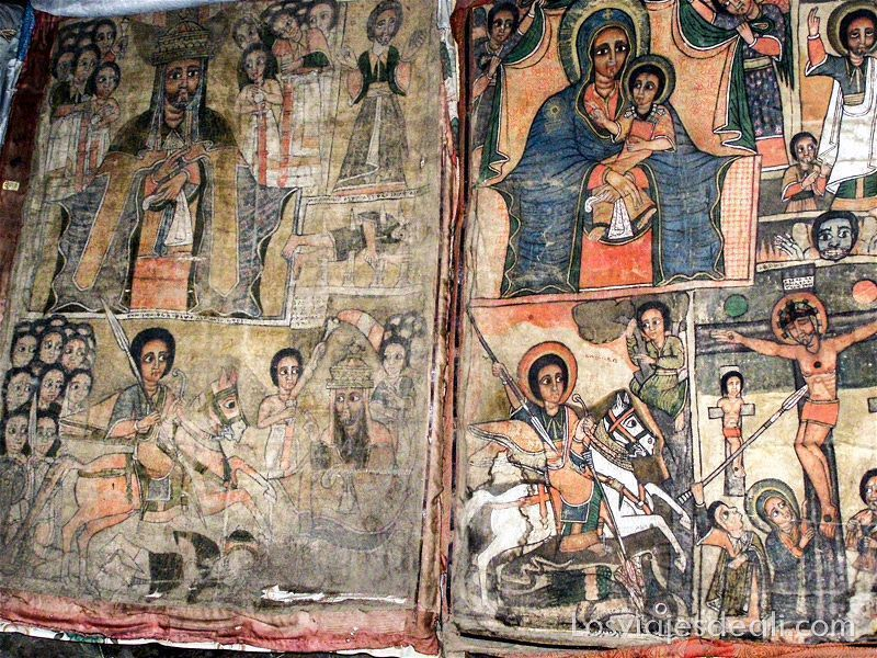 pinturas románicas pero con figuras de rasgos negros tanto la virgen como el niño jesús y cristo en iglesias de etiopía