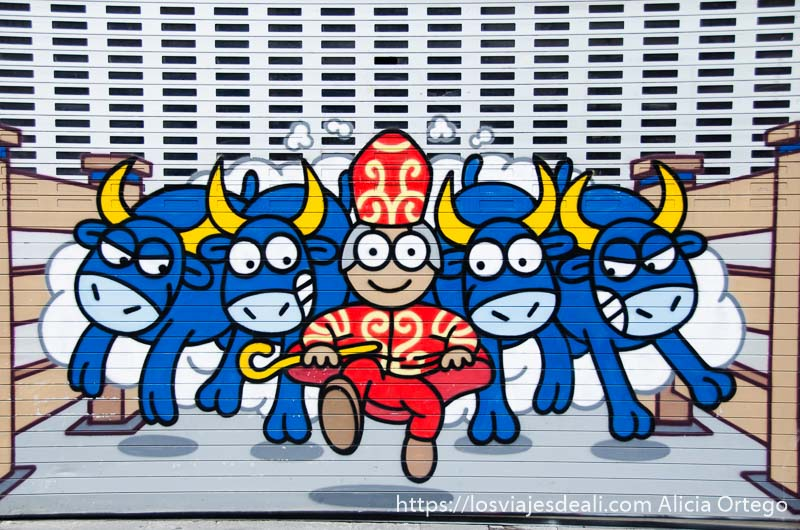 grafiti de dibujo obispo corriendo delante de toros en pamplona